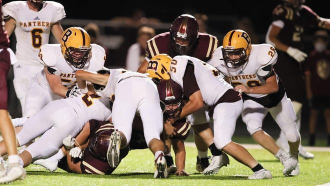 The Bells defense, led by Cole Moore (50), Aidan Brown (28) and Hank Weaver (52) get a stop near the goal line in the Panthers' 20-6 victory at Whitesboro to open the season.