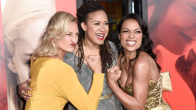 Fists were clenched at the 'Unforgettable' premiere in Hollywood, Calif., on April 18, 2017. While (left to right) stuntwoman Zoe Bell, actress Tracie Thoms and the film's star Rosario Dawson, playfully posed for photographers the TCL Chinese Theater, Dawson and her counterpart Katherine Heigl appear to bring plenty of drama to the film directed by Denise Di Novi.