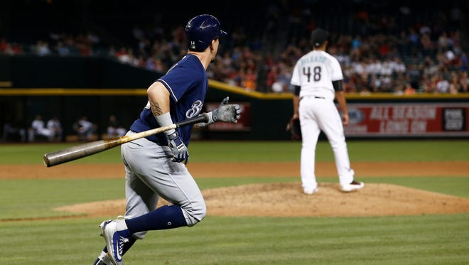 Hernan Perez, left, flips his bat as he watches his home run in the fifth inning.