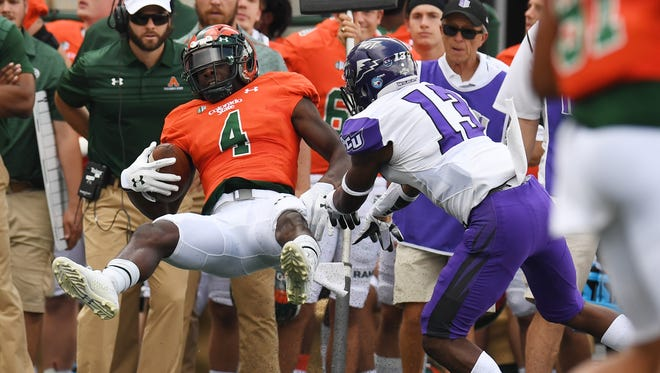 Colorado State receiver Michael Gallup (4) makes a catch while being defended by ACU's Adonis Davis (13). CSU beat the Wildcats 38-10 in the nonconference game Saturday, Sept. 9, 2017 in Fort Collins, Colorado.