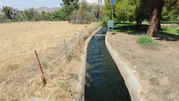 Water from Lake Success flows through a concrete-lined
