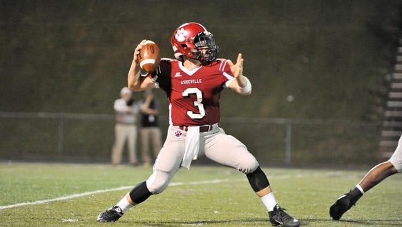 Asheville's quarterback, Three Hillier, during their