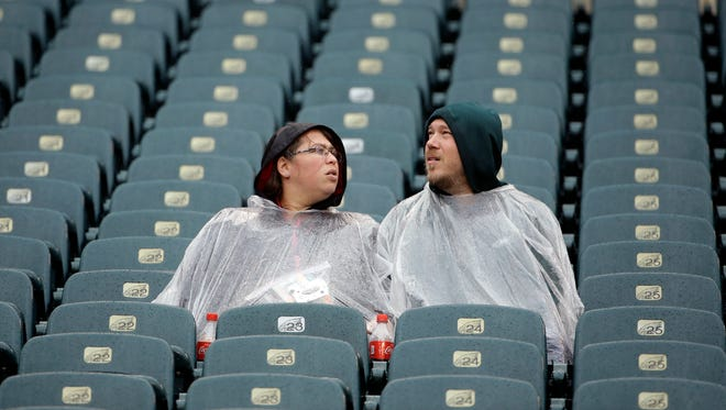 Fans sit in the rain ahead of an NFL football game between the Philadelphia Eagles and the San Francisco 49ers Sunday, Oct. 29, 2017, in Philadelphia.
