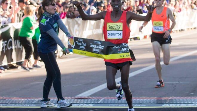 Benson Cheruiyot, of Kenya,  wins the P.F. Chang's Rock 'n' Roll Half Marathon in Tempe on Jan. 18, 2015.