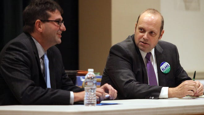 Mark Blake, Republican candidate for New Castle County Executive speaks with Matt Meyer, Democratic candidate for the office, at a debate Wednesday night.