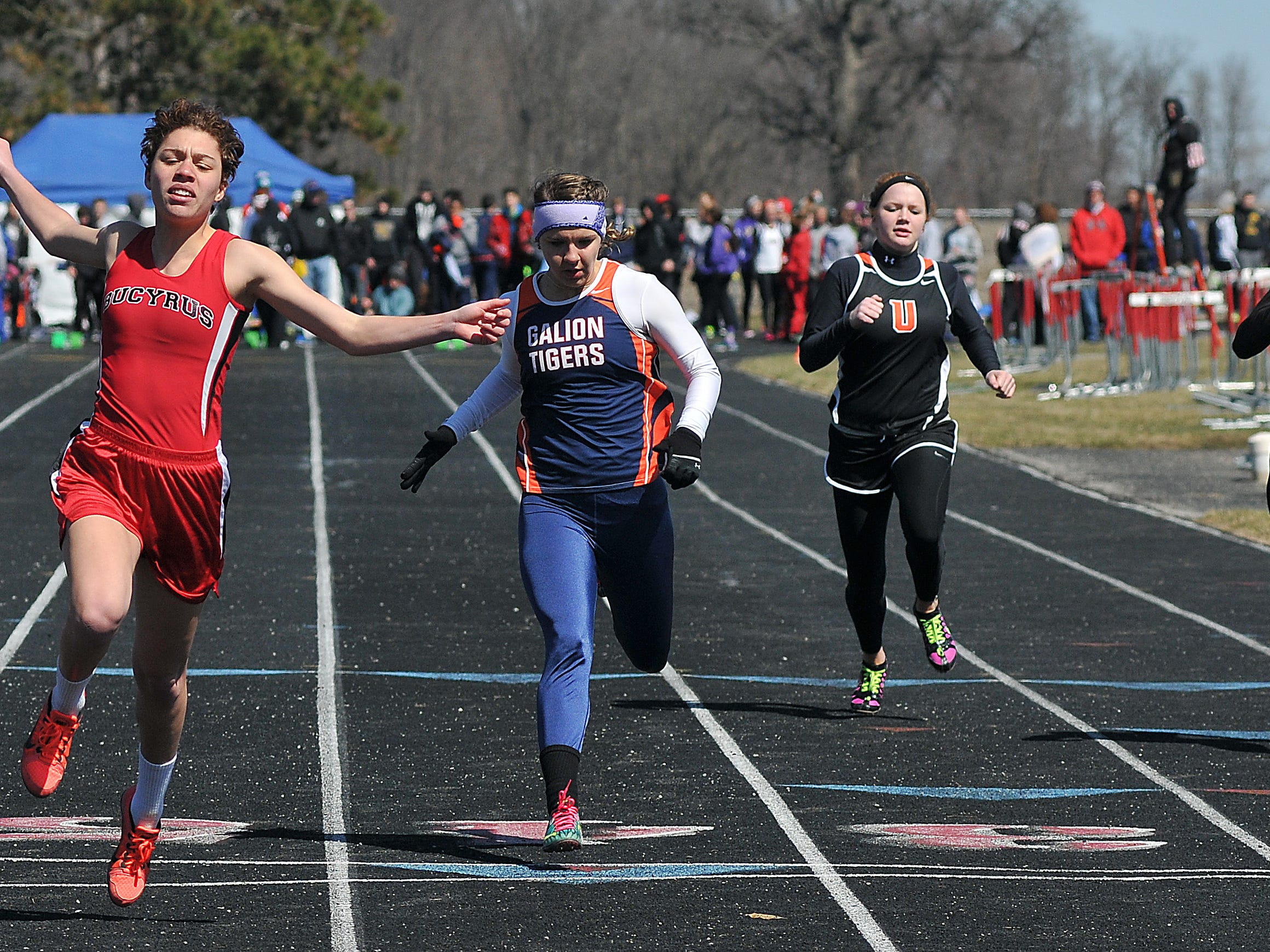 Bucyrus' Brittany Parsel crosses the finish line during the Girls 100 Meter Dash at the Bucyrus Elks 156 Invitaional Saturday at Bucyrus High School.