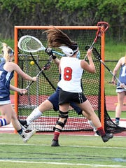 Sammy Jost (8) and the Lakeland girls' lacrosse team captured their second-straight Passaic County Tournament title in 2017 with a 17-6 victory over Wayne Valley.