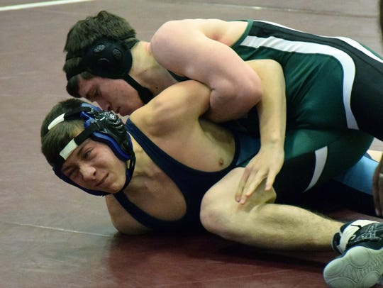 Wilson Memorial's Michael Deegan, top, works over Page