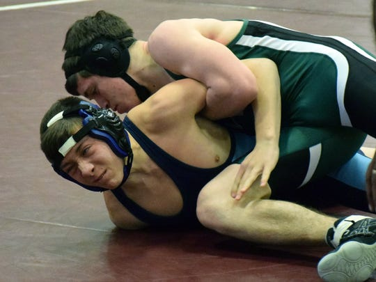 Wilson Memorial's Michael Deegan, top, works over Page County's Cameron Brown during their 132-pound bout at the VHSL Conference 36 wrestling championships on Saturday, Feb. 4, 2017, at Stuarts Draft High School.