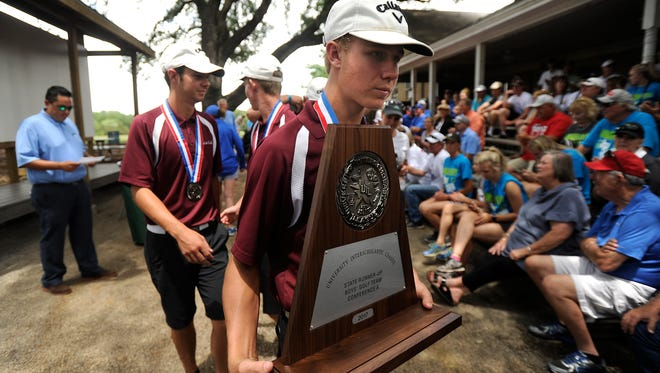 Eula's Gunner Cauthen carries the state runner-up trophy after the Pirates were honored for their second place team finish in the Class 1A boys UIL State Golf Tournament on Tuesday, May 23, 2017, at Lions Municipal Golf Course in Austin.