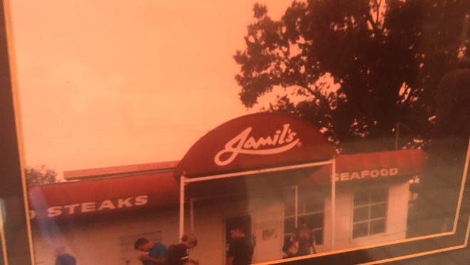 Jamil's steakhouse in Tulsa is one of the few places Tom Izzo remembers from 31 years ago - a favorite of the Tulsa coaching staff. The original Jamil's was demolished for a highway nine years ago, but this photo hangs in the new location.