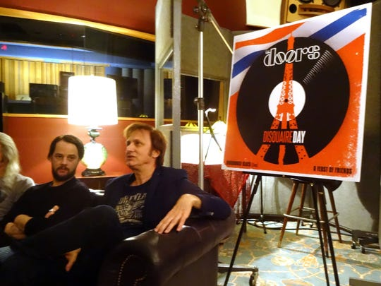 Michael Kurtz (right), co-founder of Record Store Day, and Lee Foster, manager of Electric Lady Studios, sit next to a poster advertising a special release by The Doors during a news conference last month in New York.