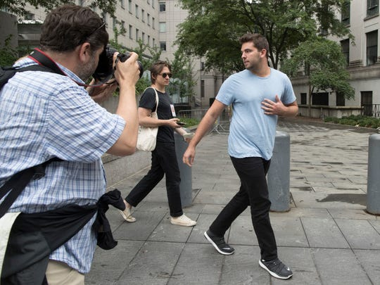 Fyre Festival founder Billy McFarland, right, is followed