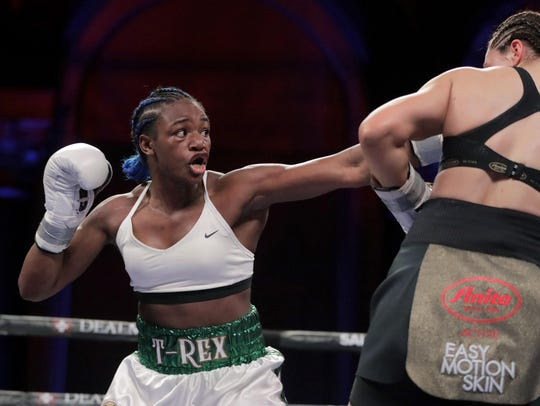 Claressa Shields, left, throws a left at Christina