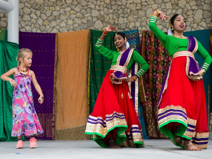 Mary Ashford, 5, left, learns traditional Indian dance