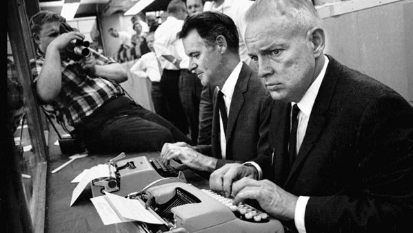 Press-Gazette writers Art Daley, center, and Lee Remmel, right, work in the Lambeau Field press box during the Packers' preseason game against the Pittsburgh Steelers on Aug. 27, 1966. Daley covered the Packers for the Press-Gazette from 1941 to 1968; Remmel did so from 1945 to 1974, then joined the Packers as director of public relations.