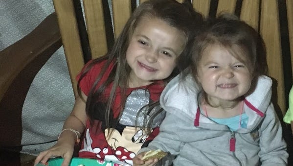 Lilly Waeghe, left, died of complications from Alpers syndrome Feb. 13, 2018.  She's shown here with her sister Riley, who also has the disease.