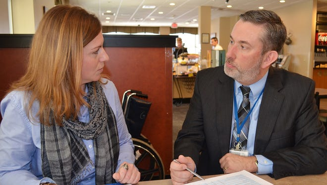 Melanie Wells, community wellness coordinator at WellSpan Good Samaritan Hospital in Lebanon, reviews the findings of the WellSpan Community Health Needs Assessment survey with Kevin Alvarnaz, director of community health and wellness for WellSpan Health System.