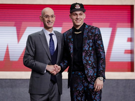 Whitnall High School grad Tyler Herro poses with NBA commissioner Adam Silver after being drafted No. 13 by the Miami Heat last month.