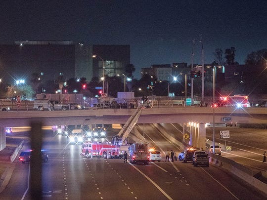 Police and fire officials along with the Arizona Department of Public Safety temporarily closed a portion on Interstate 10 Friday night after a man climbed out on the overpass.