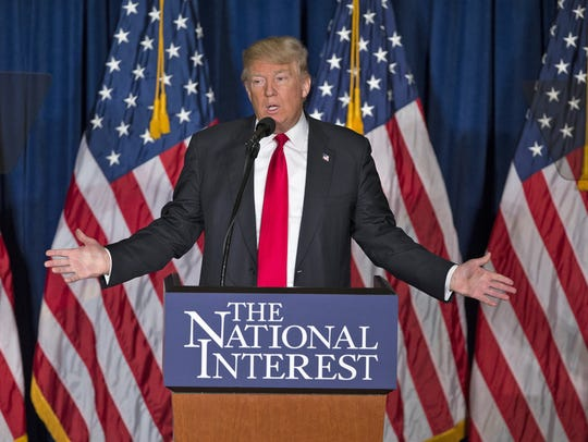 Republican presidential candidate Donald Trump gives