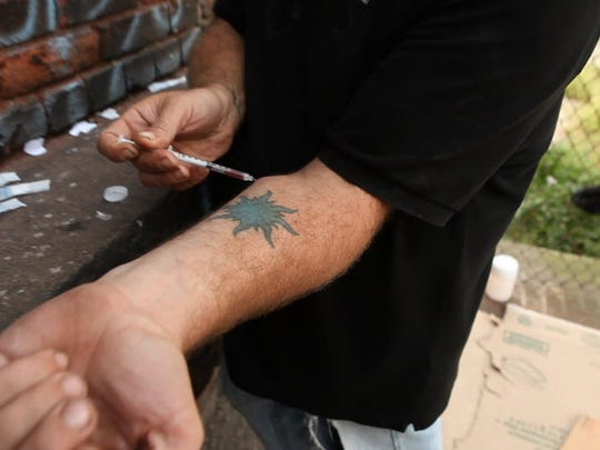 Heroin user shooting up in Paterson.