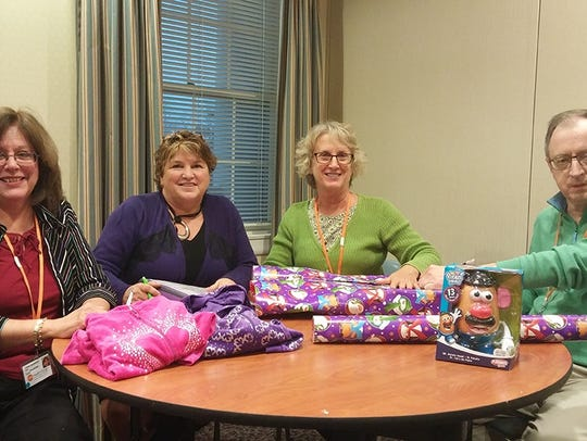 "Volunteers did a ""fantastic job"" wrapping gifts in"