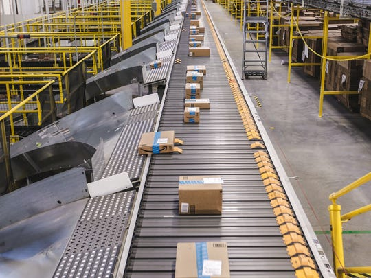 Boxes on a conveyor belt in an Amazon fulfillment center