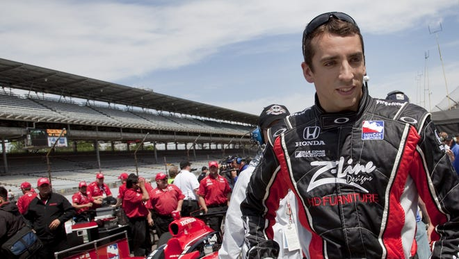 FILE -- Justin Wilson waits for a television interview after his qualifying attempt on May 10, 2009 at the Indianapolis Motor Speedway.