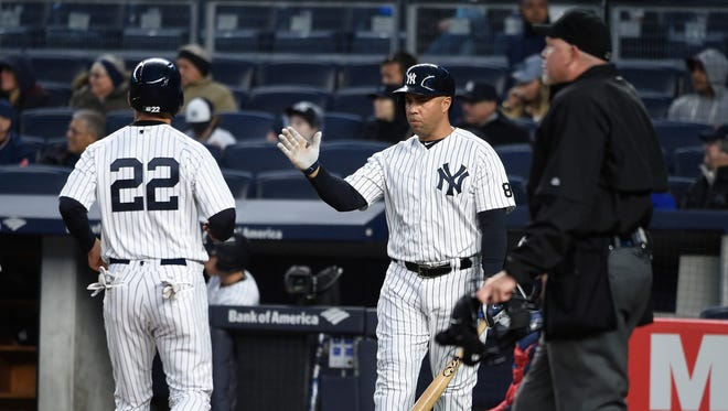 New York Yankees Carlos Beltran greets Jacoby Ellsbury (22) at home plate after Ellsbury scored on Brian McCann's single off of Boston Red Sox starting pitcher Rick Porcello in the first inning of a baseball game, Friday, May 6, 2016, in New York.