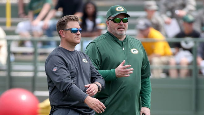 Packers head coach Mike McCarthy, right, talks with general manager Brian Gutekunst during Green Bay Packers minicamp at Ray Nitschke Field Tuesday, June 12, 2018 in Ashwaubenon, Wis.