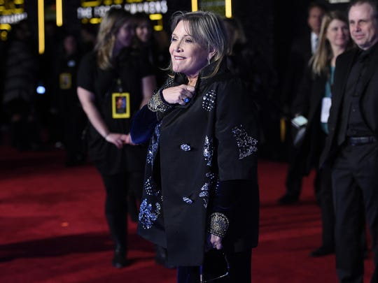 """Carrie Fisher arrives at the world premiere of """"Star Wars: The Force Awakens"""" at the TCL Chinese Theatre in Los Angeles."""