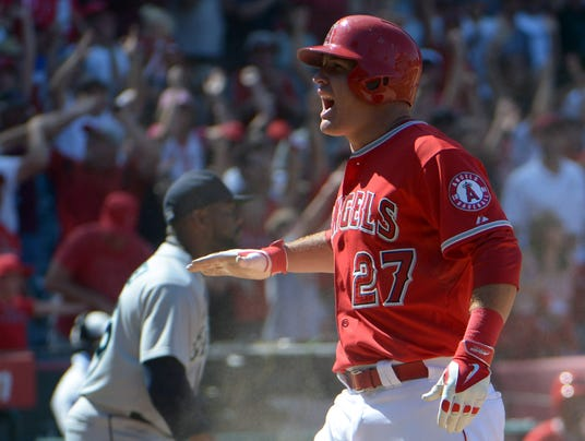Mike trout scored 115 runs and became the first player to lead the