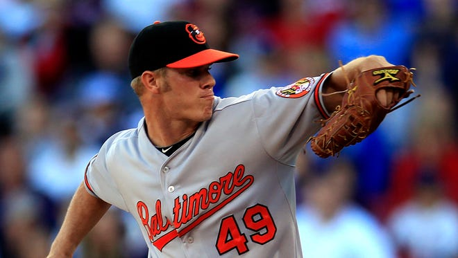 Baltimore Orioles' Dylan Bundy winds up for a pitch against the Boston Red Sox in the eighth inning of a baseball game at Fenway Park, in Boston, Sunday, Sept. 23, 2012. The Red Sox won 2-1.