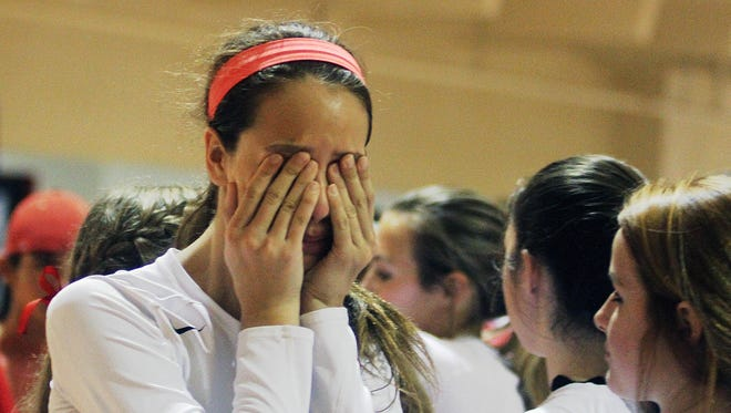 Evangelical Christian School's Lily Tessier cries after ECS lost to Palmer Trinity on Saturday at ECS in Fort Myers.
