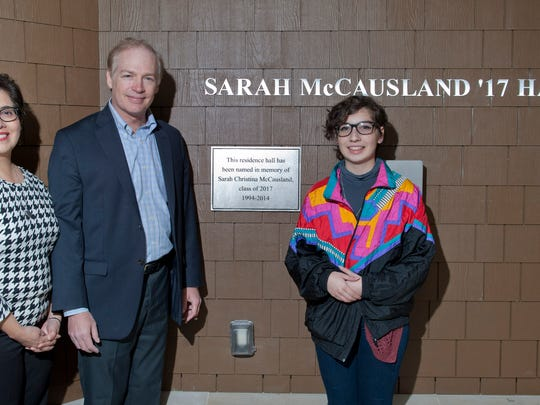 From left, Sandra McCausland, Andrew McCausland and Tori McCausland, parents and sister of Sarah McCausland, stand for a portrait after Bard College dedicated Saturday October 24, 2015 a dormitory Sarah's name in the Town of Red Hook. Sarah McCausland was killed by a drunk driver in 2014. Photo by Karl Rabe