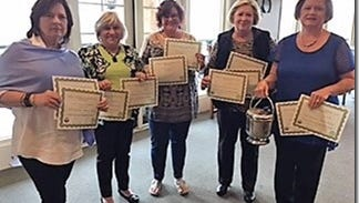 Shown are Service League members who attended the meeting holding awards from left to right are Margo Seagraves, Carol Mamay, Joy Story, Debbie Mewborn, and Lynn Vickery, president of Hartwell Service League.