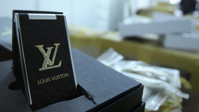 A Louis Vuitton logo shown in this 2011 file photo.