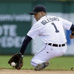 Detroit Tigers shortstop Jose Iglesias fields a ground ball for an out against Chicago White Sox's Alexei Ramirez during the fourth inning of a baseball game Sunday in Detroit.