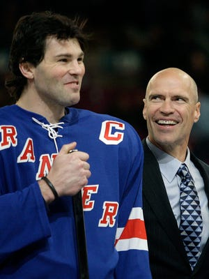 In this Dec. 19, 2006, file photo, former Rangers' Mark Messier smiles towards Jaromir Jagr, left, of the Czech Republic, at Madison Square Garden in New York. Jagr is closing in on become the second all-time leading scorer in NHL history. The 44-year-old Florida Panthers wing is within striking distance of passing Messier, who had 1,887 points from 1979-2004.