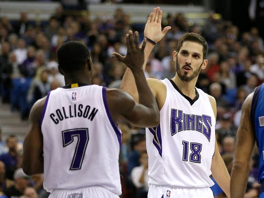 FILE - In this Nov. 30, 2015, file photo, Sacramento Kings forward Omri Casspi, right, high-fives teammate Darren Collison after scoring during the Kings' NBA basketball game against the Dallas Mavericks in Sacramento, Calif. When Casspi was 13, his family took him on a Bar Mitzvah trip to the United States, the highlight of which was a visit to New York City where the Israeli youngster stood in front of Madison Square Garden and boldly vowed he would one day play there.(AP Photo/Rich Pedroncelli, File)