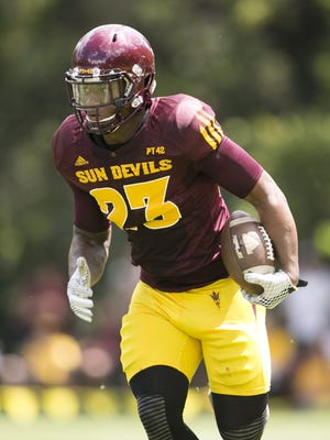 ASU running back Jason Lewis carries the ball during an ASU football scrimmage at Camp Tontozona in the Tonto National Forest outside of Payson on August 15, 2015.