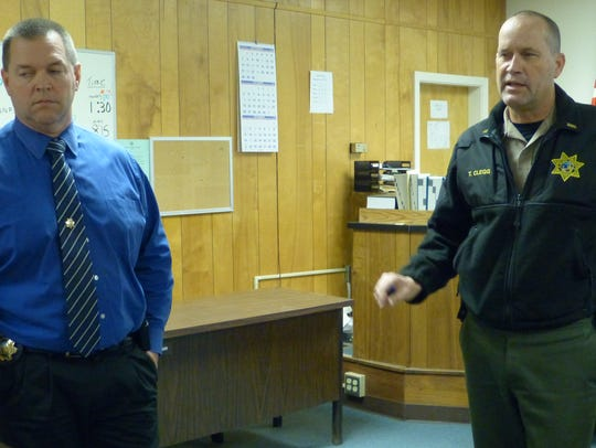 Lt. Anthony Bertain (left) and Lt. Troy Clegg conduct