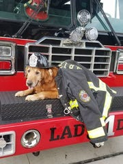 Howard poses on a White River Township Fire Department