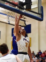 Philo's Isaac Gill goes up for a shot in the lane against