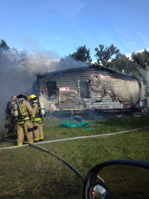 Firefighters responded as a fire engulfed a manufactured home near Scottsmoor Monday morning.