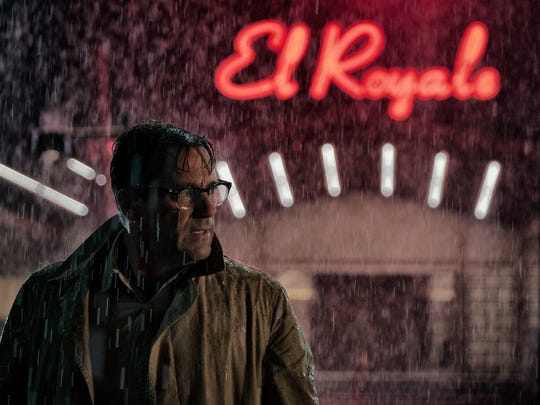 "Laramie (Jon Hamm) gets caught in the rain in ""Bad Times at the El Royale."""