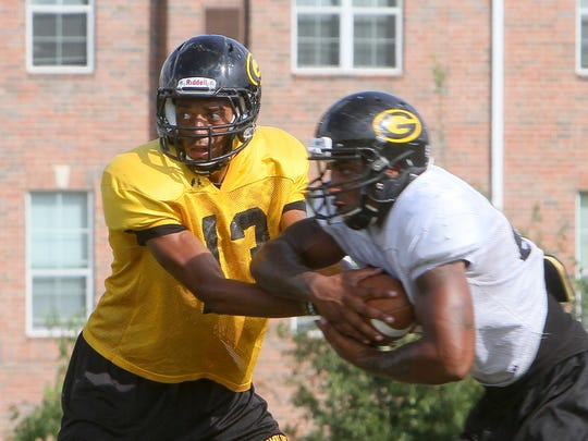 Current UK quarterback Stephen Johnson (13) hands off the ball during a Grambling practice Wednesday, Sept. 17, 2014, on the Tigers' practice field in Grambling, La.
