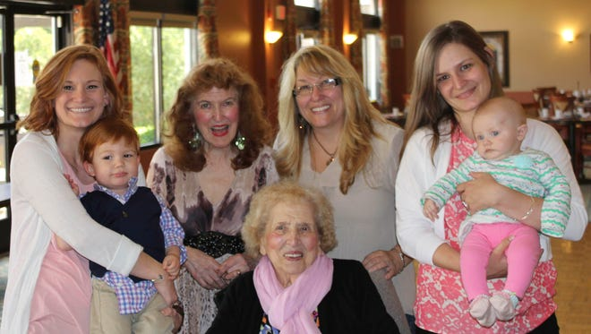 Margaret LaFrado, seated, surrounded by four generations of her family.