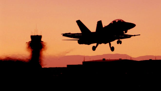 An F-18 hornert takes off for a night mission from the Fallon Naval Air Station near Fallon on Aug. 23, 2006. Photo by Marilyn Newton